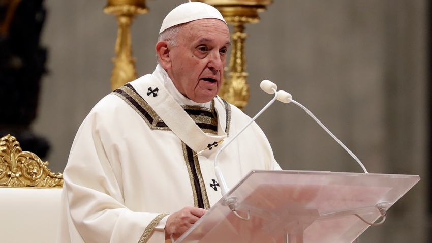 In this Dec. 24, 2019, file photo, Pope Francis celebrates Christmas Eve Mass in St. Peter's Basilica at the Vatican.