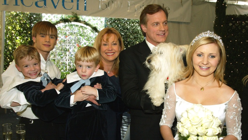 """In this file photo, actors (L to R) David Gallagher, twins Lorenzo and Nikolas Brino, Catherine Hicks, Stephen Collins and Beverley Mitchell pose at a reception to celebrate 150 episodes of The WB's """"7th Heaven"""" on February 20, 2003 in Los Angeles, California."""