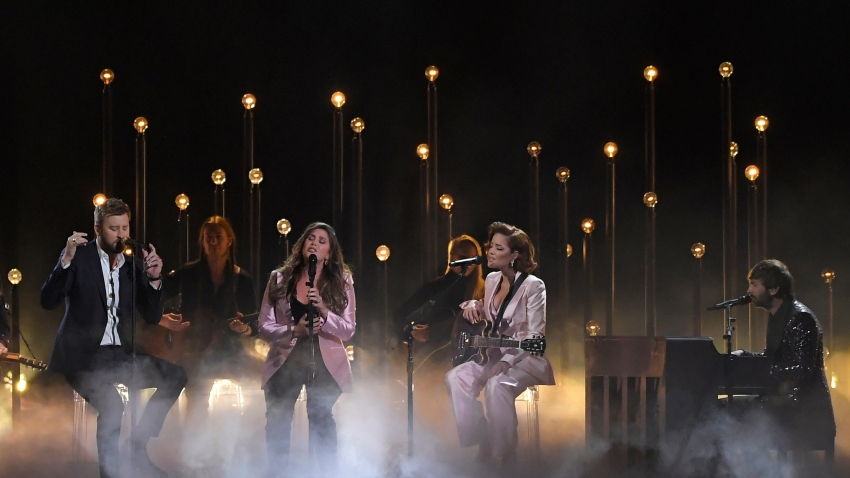 "Charles Kelley, left, Hillary Scott, second left and Dave Haywood, right, of Lady Antebellum perform ""What if I Never Get Over You"" and ""Graveyard"" with Halsey, second from right at the 53rd annual CMA Awards at Bridgestone Arena, Wednesday, Nov. 13, 2019, in Nashville, Tenn."