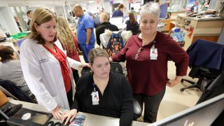 Kathleen Sheehan, left, director of Emergency and Trauma Services, speaks with Sarah Horn, center, and Lead Case Manager Jeanne Icolari in the Emergency room at St. Luke's Cornwall Hospital in Newburgh, New York, Dec. 19, 2019.