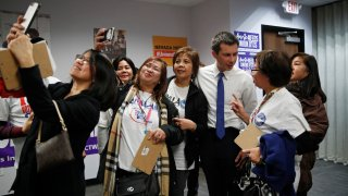 Former South Bend Mayor Pete Buttigieg meets with people at a town hall event with Asian American and Pacific Islander voters