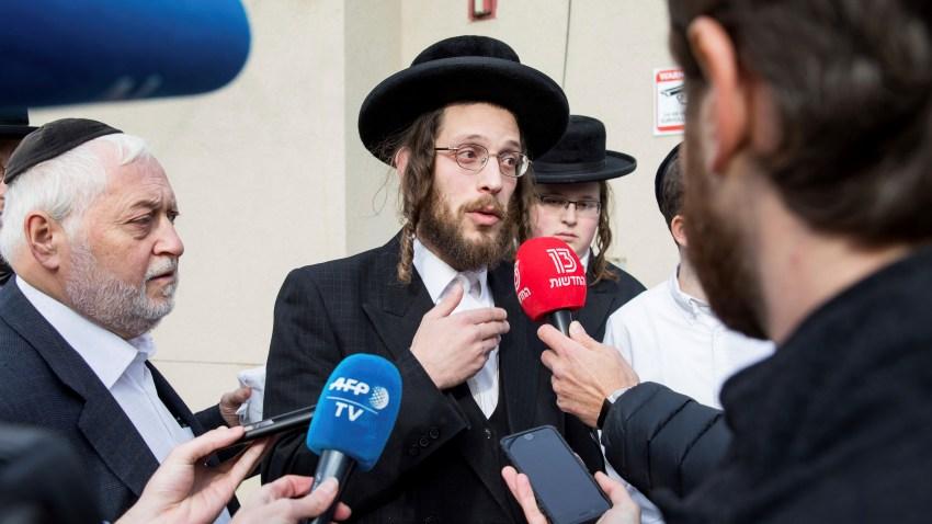 Josef Gluck speaks to reporters