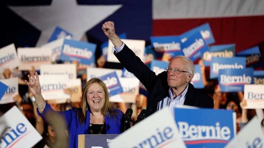 Democratic presidential candidate Sen. Bernie Sanders, I-Vt., right, with his wife Jane, raises his hand as he speaks during a campaign event in San Antonio, Saturday, Feb. 22, 2020. (AP Photo/Eric Gay)