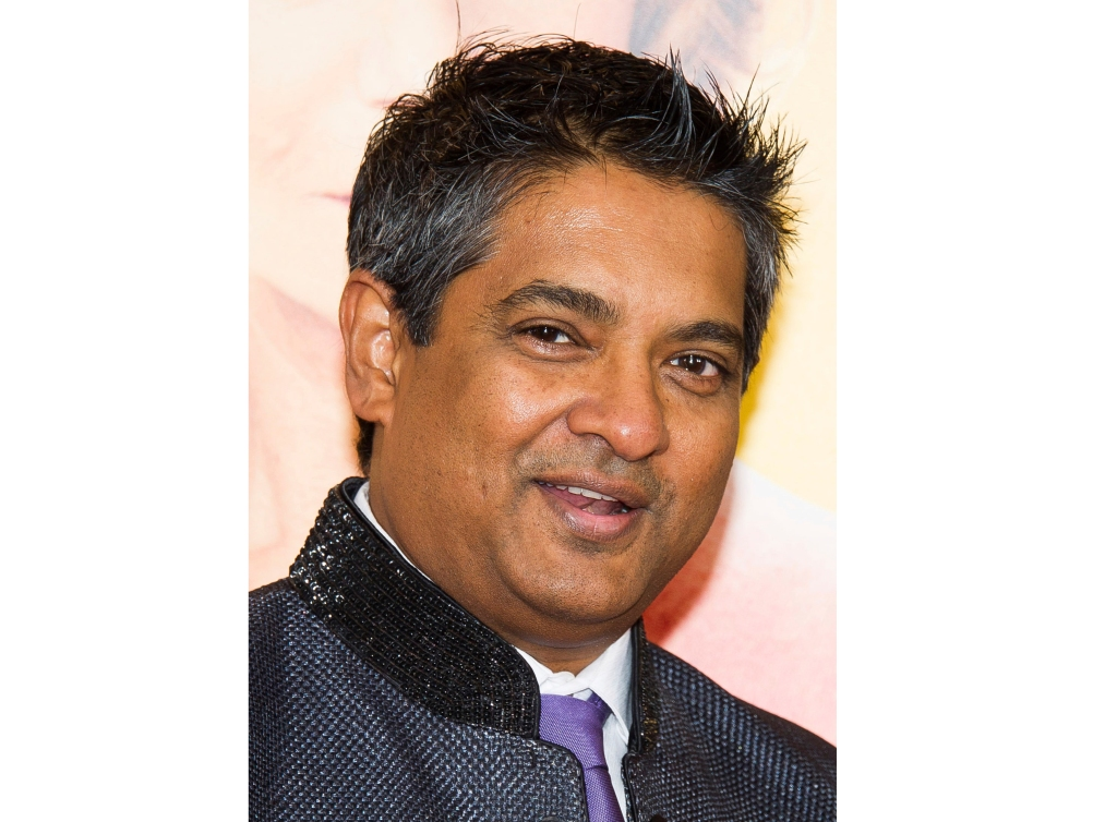 "FILE - This Aug. 4, 2014 file photo shows chef Floyd Cardoz at ""The Hundred-Foot Journey"" premiere in New York. Cardoz, who competed on ""Top Chef,"" won ""Top Chef Masters"" and operated successful restaurants in both India and New York, has died of complications from the coronavirus, his company said Wednesday. He was 59."