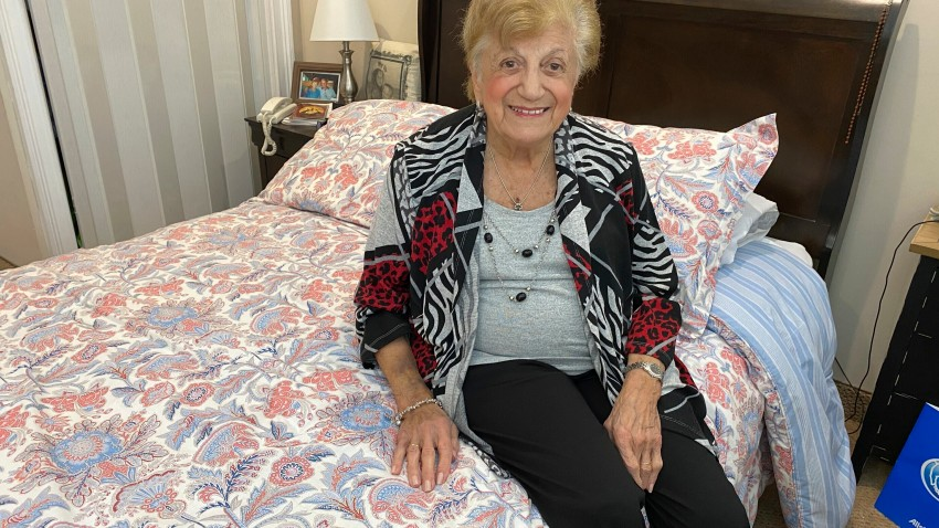 """COVID-19 survivor Anna Fortunato poses for a portrait in her room at The Arbors assisted living community in Jericho, N.Y. on Tuesday, March 31, 2020. Fortunato, 90, says people should keep fighting the new coronavirus and that, """"If I did it, you can do it."""""""