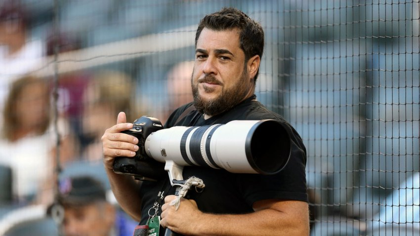In this Aug. 2, 2016, photo provided by Christopher Pasatieri, New York Post photographer Anthony J. Causi is shown before a New York Mets baseball game in New York. Causi, a highly skilled and exceedingly popular sports photographer for The New York Post who covered the city's teams for 25 years, died Sunday, April 12, 2020, from the new coronavirus