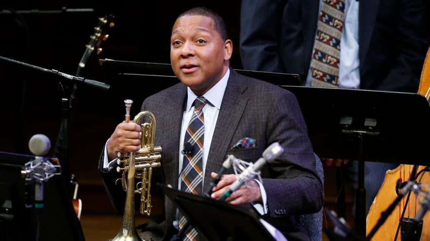 FILE - In this Jan. 30, 2014 file photo, Musician Wynton Marsalis speaks during a lecture performance at Harvard University's Sanders Theatre in Cambridge, Mass