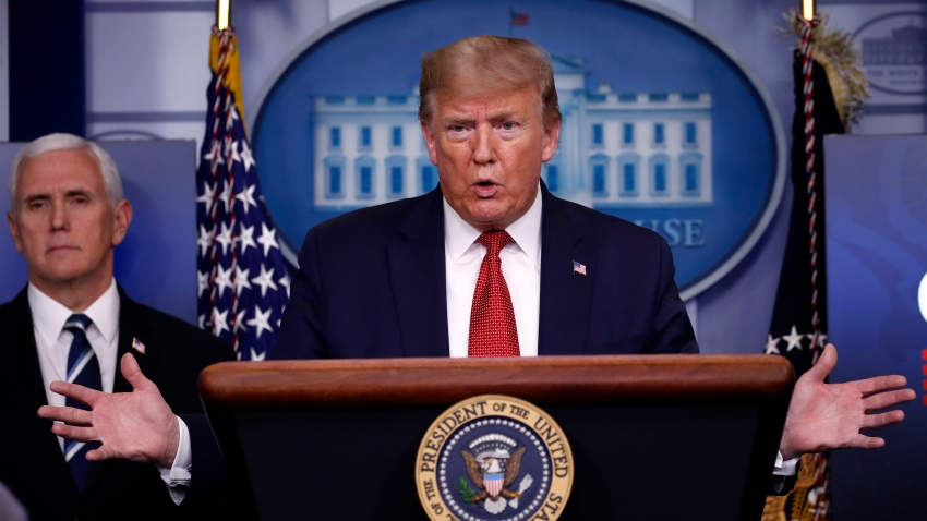 President Donald Trump speaks about the coronavirus in the James Brady Press Briefing Room of the White House, Thursday, April 16, 2020, in Washington, as Vice President Mike Pence listens.