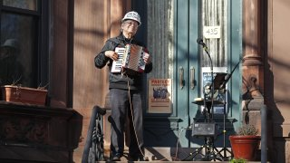 musician stands on his porch