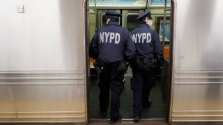 police officers enter subway