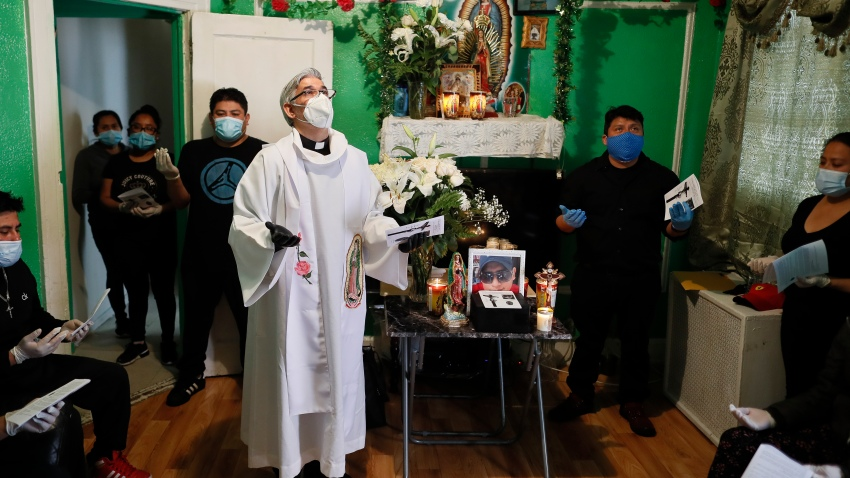 priest stands in living room