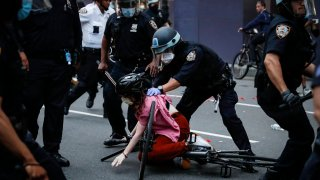NYPD officers arrest a protester