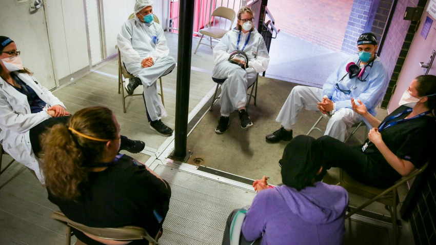 Hospital workers sit for a group counseling session at Elmhurst Hospital to talk about their experiences dealing with the COVID-19 pandemic, Friday, May 29, 2020, in New York.