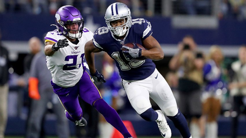 Amari Cooper #19 of the Dallas Cowboys carries the ball against Mike Hughes #21 of the Minnesota Vikings in the fourth quarter at AT&T Stadium on Nov. 10, 2019 in Arlington, Texas.