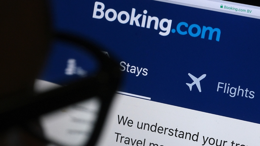 A man looks at the website of Booking.com, April 20, 2020, in Katwijk, Netherlands.
