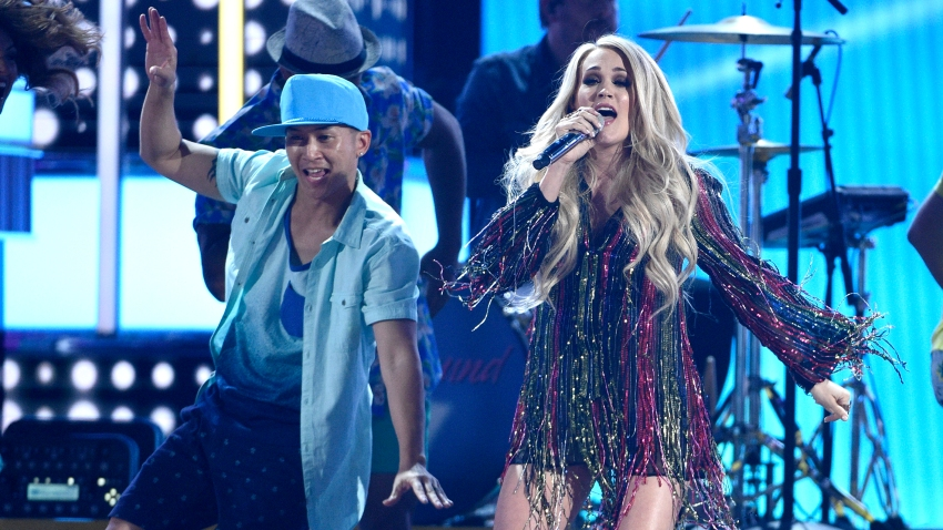 """In this file photo, Carrie Underwood, right, performs """"Southbound"""" at the 54th annual Academy of Country Music Awards at the MGM Grand Garden Arena on Sunday, April 7, 2019, in Las Vegas."""