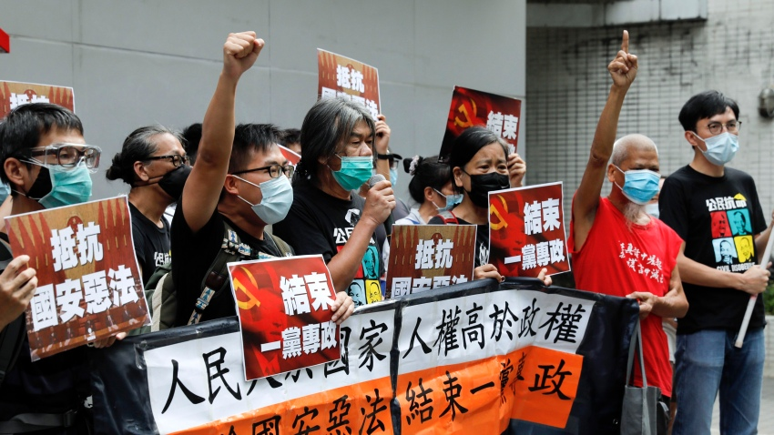 "Pro-democracy Leung Kwok-hung, center, and others protesters shout slogans "" Stop One Party Rolling"" before they march toward the flag raising ceremony marking the anniversary of the Hong Kong handover to China in Hong Kong, Wednesday, July 1, 2020. Hong Kong marked the 23rd anniversary of its handover to China in 1997, one day after China enacted a national security law that cracks down on protests in the territory."