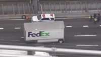 Truck Loses FedEx Delivery on GWB