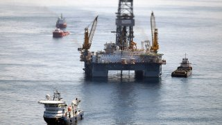 Ships work near the site of the BP Deepwater Horizon oil spill on Aug. 3, 2010, in the Gulf of Mexico off the coast of Louisiana.