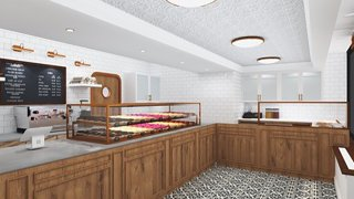 A Dough Doughnuts shop featuring wooden accents and a white background. A variety of doughnuts can be seen behind a counter glass.