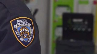 NYPD officer stands in frame
