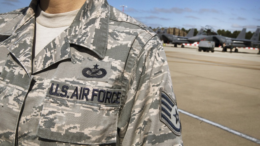 In this Thursday, June 27, 2019, file photo, a United States Air Force insignia decorates an officer's uniform near a Boeing Co. F15-E Strike Eagle combat aircraft of the 48th Fighter Wing while taking part in the joint NATO exercise ''Point Blank'' from their base at RAF Lakenheath, near Brandon, Suffolk, United Kingdom.
