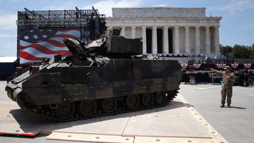 Members of the U.S. Army park an Bradley fighting vehicle in front of the Lincoln Memorial