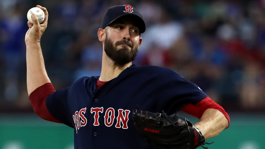Rick Porcello of the Boston Red Sox throws against the Texas Rangers in the first inning at Globe Life Park in Arlington on September 25, 2019 in Arlington, Texas.