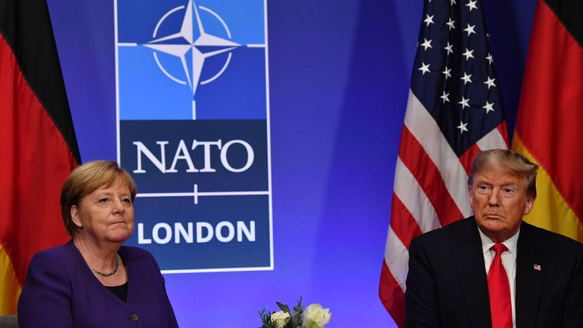 German Chancellor Angela Merkel and U.S. President Donald Trump hold a bilateral meeting on the sidelines of the NATO summit at the Grove hotel in Watford, northeast of London on Dec. 4, 2019.