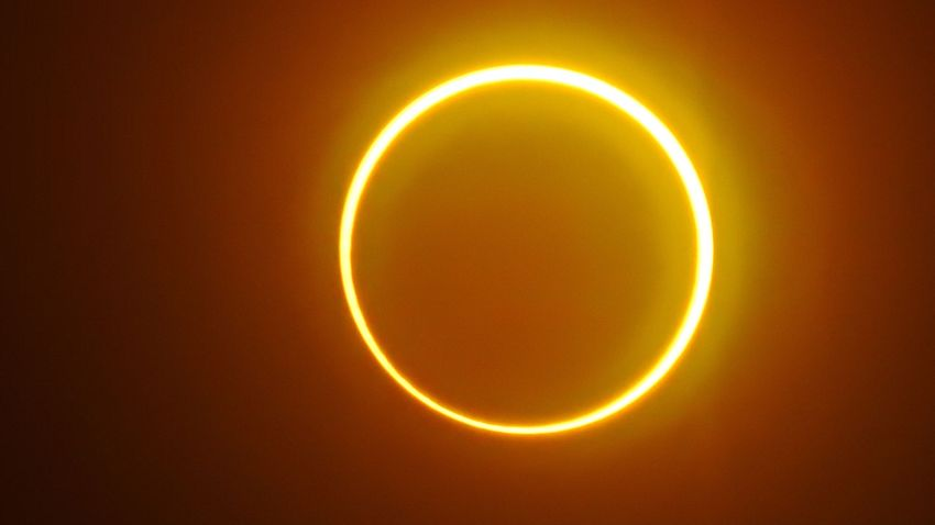 """The moon moves in front of the sun in a rare """"ring of fire"""" solar eclipse"""