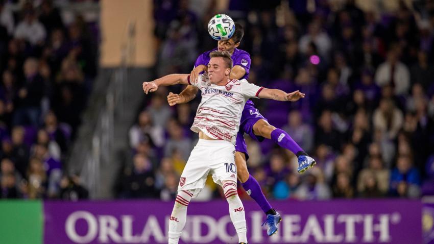 Orlando City midfielder João Moutinho (4) and Real Salt Lake forward Corey Baird (10) go up for a header during the soccer match between Real Salt Lake and Orlando City SC. on Feb. 29, 2020, at Exploria Stadium in Orlando Florida.