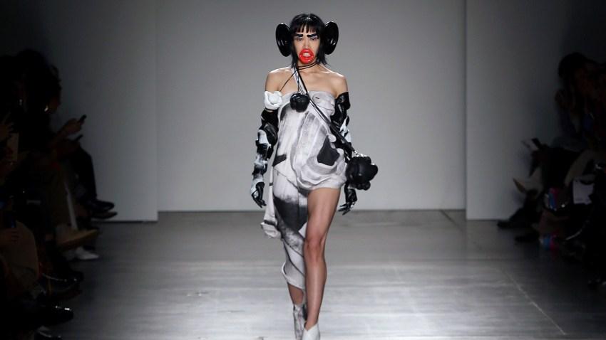 model walks down runway
