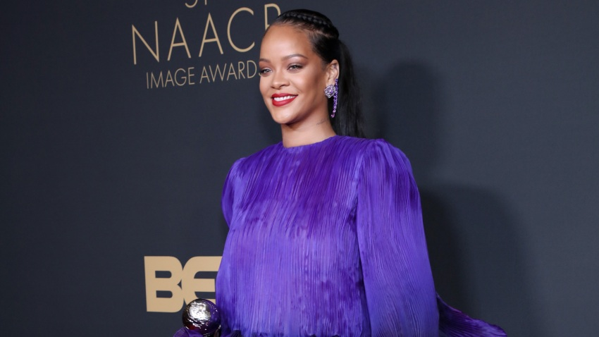 Rihanna poses on the red carpet.