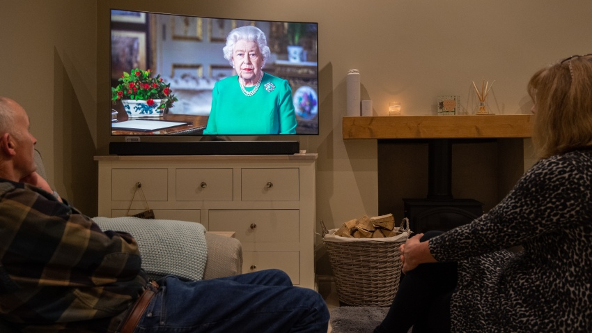 People in Leicester watch Queen Elizabeth II deliver her address to the nation and the Commonwealth in relation to the coronavirus epidemic.