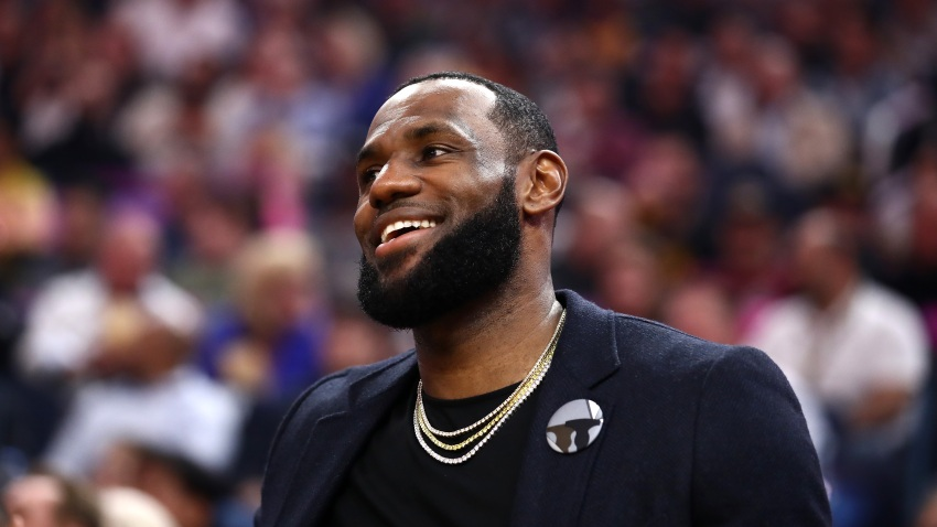 LeBron James of the Los Angeles Lakers sits on the bench injured during their game against the Golden State Warriors at Chase Center on Feb. 27, 2020 in San Francisco.
