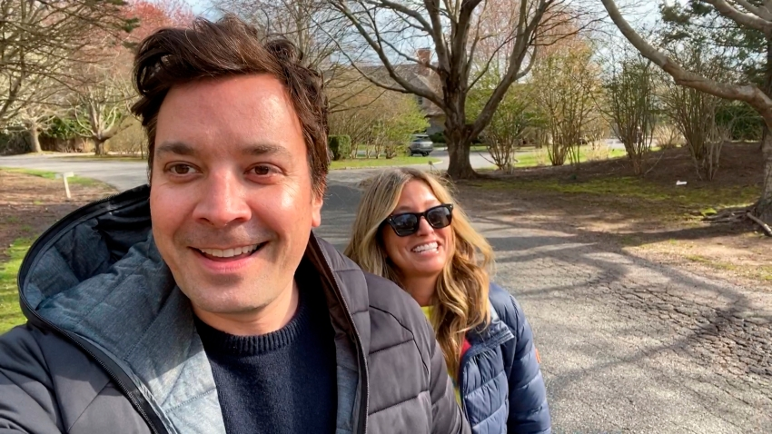 """In this April 14, 2020,, file photo, """"Tonight Show"""" host Jimmy Fallon and wife Nancy Juvonen discuss their fertility struggles during a """"Tonight Show"""" home edition."""