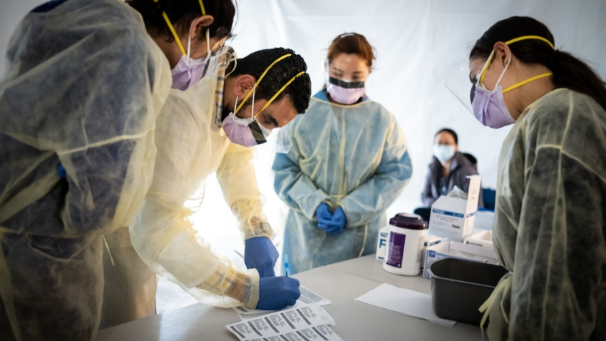 Medical professionals in protective masks and gowns