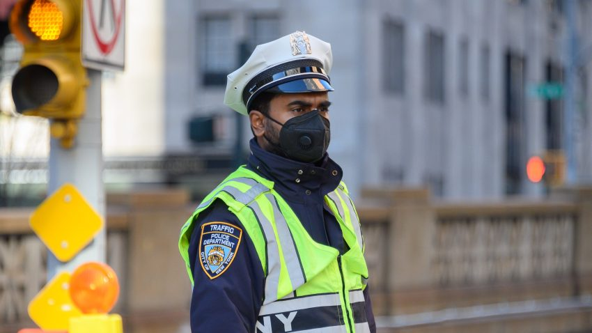 police officer wears protective mask