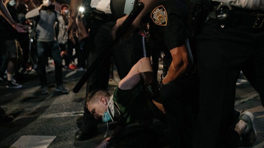 Protester arrested by NYPD officers