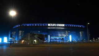 Metlife Stadium is illuminated in blue to honor essential workers on April 09, 2020 in East Rutherford, New Jersey.
