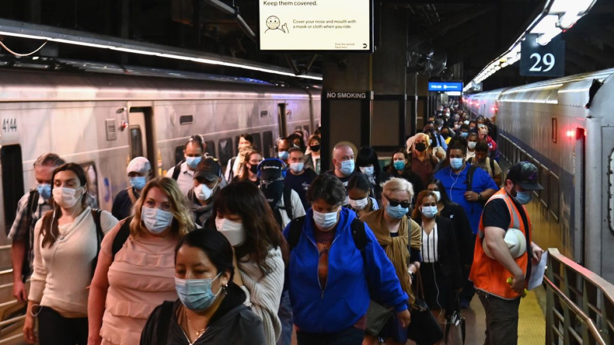 people in masks at new york city subway station