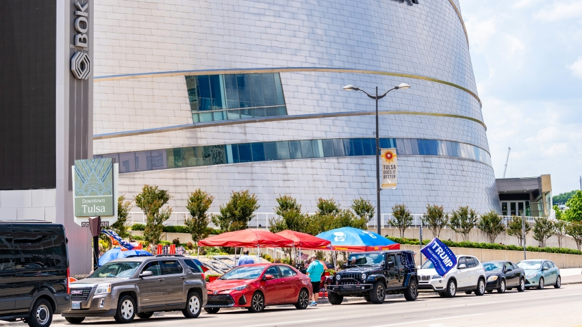 Vehicles sit parked outside of the BOK Center ahead of a rally for U.S. President Donald Trump in Tulsa, Oklahoma, U.S., on Wednesday, June 17, 2020.