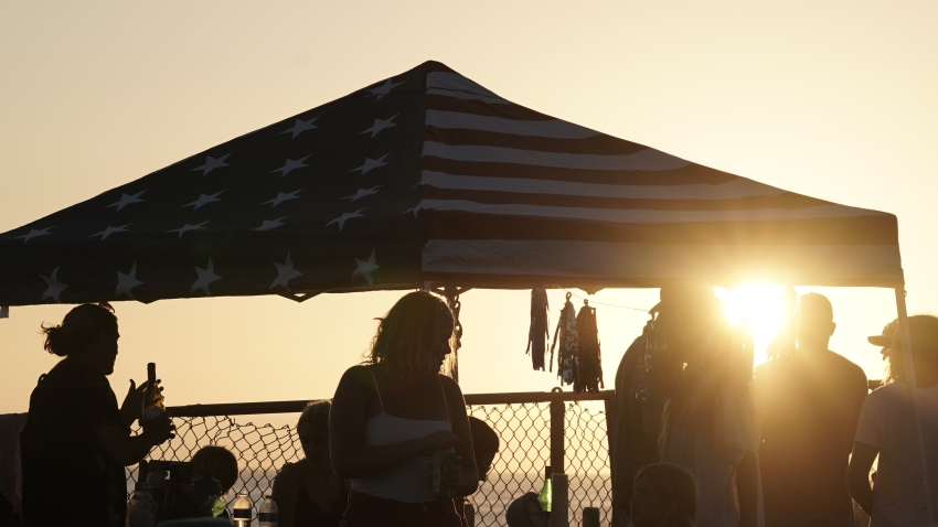 People gather under a canopy at sunset in Encinitas, Californi