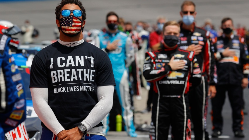 "Bubba Wallace, driver of the #43 McDonald's Chevrolet, wears a ""I Can't Breath - Black Lives Matter"" T-shirt under his fire suit in solidarity with protesters around the world taking to the streets after the death of George Floyd"