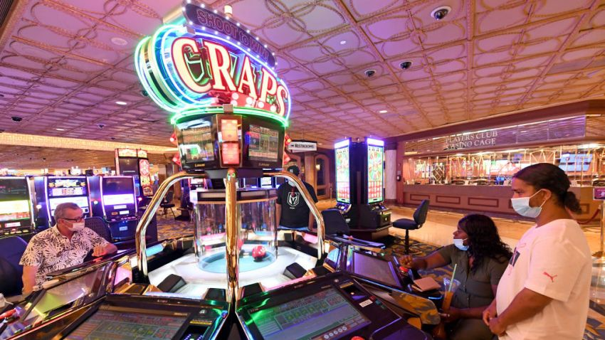 People play a video craps machine at a hotel-casino