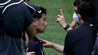 Masahiro Tanaka #19 of the New York Yankees is checked after he was hit by a batted ball during summer workouts at Yankee Stadium on July 04, 2020 in the Bronx borough of New York City