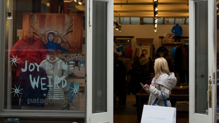 A pedestrian carrying a shopping bag walks past a Patagonia Inc. store on Wooster Street in the SoHo neighborhood of New York, U.S., on Friday, Dec. 5, 2014.
