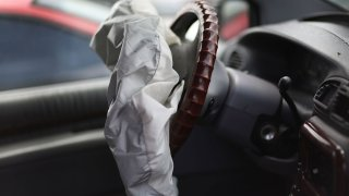 A deployed airbag is seen in a Chrysler vehicle