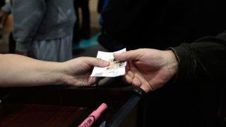 TSA agent check's passenger's ID