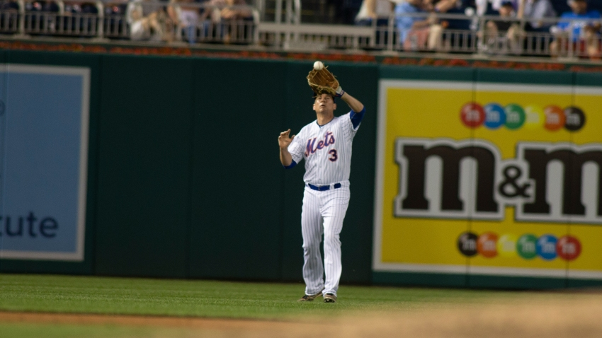 Tom Suozzi playing on Congressional Baseball game in Mets uniform